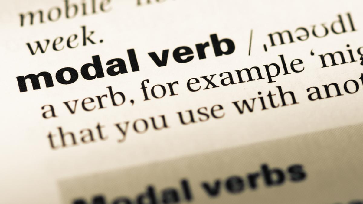 """página de um dicionário escrito """"modal verb"""""""